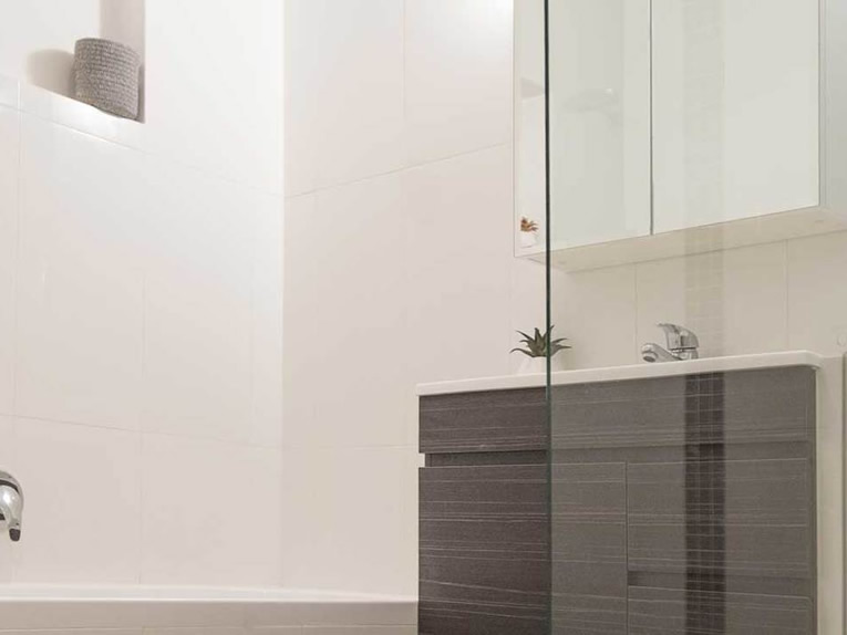 Modern bathroom renovation in Adelaide showing bath