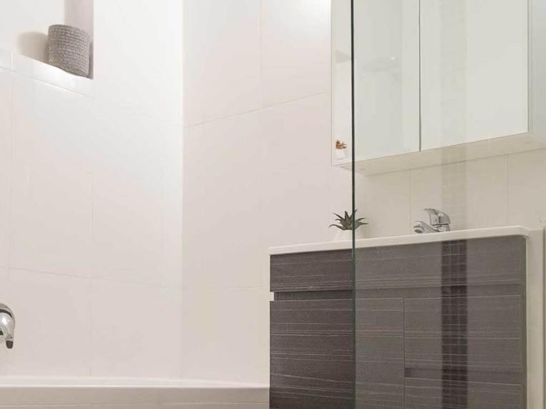 Modern bathroom renovation in Adelaide showing bath