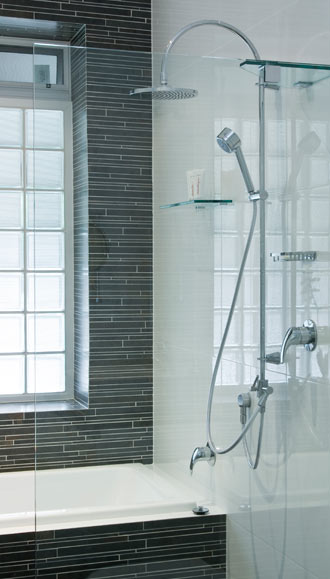 Open shower with luxurious yet efficient shower head